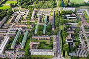 Nederland, Zuid-Holland, Rotterdam, 15-07-2012; Pendrecht (deelgemeente Charlois, Rotterdam-Zuid). Sliedrechtstraat en omgeving, strokenbouw. Rechts St. bavokerk en winkelstraat Slinge..Nieuwbouwwijk uit de jaren vijftig van de vorige eeuw, wederopbouw periode. Stedenbouwkundig ontwerp van Lotte Stam-Beese, kenmerkend zijn de ruime opzet en  veel groen. Ontworpen als wijk met verschillende woningtypen (en verschillende bewoners) en voorzien van alle voorzieningen..Pendrecht (part of Charlois, Rotterdam-South). New neighborhood (fifties of the last century), post-war reconstruction period. Urban design of Lotte Stam-Beese, characterized by spacious layout and lots of green. Designed as residential district with different housing types.. .QQQ.luchtfoto (toeslag), aerial photo (additional fee required).foto/photo Siebe Swart