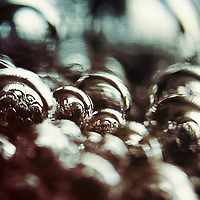 Surreal and abstract still life image of reflective baubles