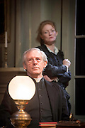 24/09/2013. The Rose Theatre Kingston and English Touring Theatre present Ghosts by Henrik Ibsen. Directed by Stephen Unwin. Featuring Pip Donaghy, Patrick Drury, Florence Hall, Kelly Hunter & Mark Quartley. Picture: Patrick Drury (Pastor Manders) & Kelly Hunter (Mrs Alving).