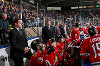 KELOWNA, BC - MARCH 03:  Portland Winterhawks' associate coach Kyle Gustafson stands on the bench with head coach Mike Johnston and assistant coach Don Hay against the Kelowna Rockets at Prospera Place on March 3, 2019 in Kelowna, Canada. (Photo by Marissa Baecker/Getty Images)