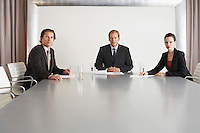 Three Businesspeople in Conference Room