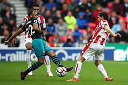 Joe Allen of Stoke City challenges Nathan Redmond of Southampton - Mandatory by-line: Matt McNulty/JMP - 30/09/2017 - FOOTBALL - Bet365 Stadium - Stoke-on-Trent, England - Stoke City v Southampton - Premier League
