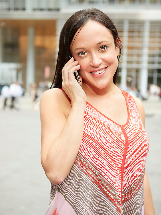 Lifestyle image of woman talking on cellphone in Midtown Manhattan