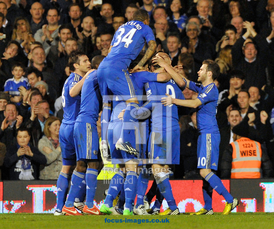 Picture by Alan Stanford/Focus Images Ltd +44 7915 056117.17/04/2013.Chelsea players celebrate John Terry's  goal with Ryan Bertrand leaping on them during the Barclays Premier League match at Craven Cottage, London.