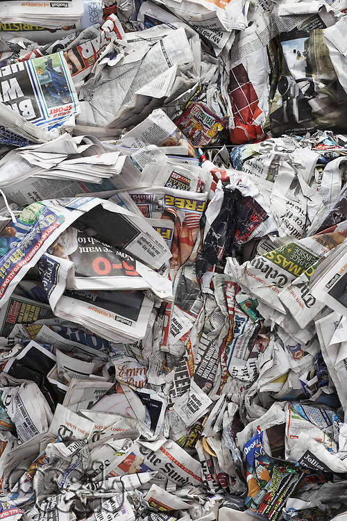 Pile of scrunched up newspapers full frame