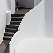 White house walls with black stairs inside