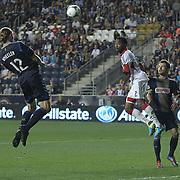 Philadelphia Union Forward AARON WHEELER (12) attempts head the ball towards the goal as D.C. United Defender JAMES RILEY (2) defends in the second half a MLS regular season match against D.C. United Saturday. August. 10, 2013 at PPL Park in Chester PA.