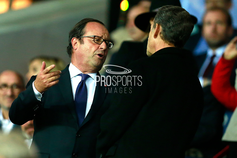 Former French presidents Francois Hollande and Nicolas Sarkozy chat during the UEFA Champions League, Group B football match between Paris Saint-Germain and Bayern Munich on September 27, 2017 at the Parc des Princes stadium in Paris, France - Photo Benjamin Cremel / ProSportsImages / DPPI