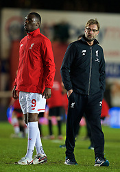 EXETER, ENGLAND - Friday, January 8, 2016: Liverpool's Christian Benteke warms-up as manager Jürgen Klopp looks on before the FA Cup 3rd Round match against Exeter City at St. James Park. (Pic by David Rawcliffe/Propaganda)