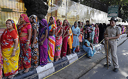 November 12, 2016 - Jaipur, Rajasthan, India - Indian women stands in a queue  to deposit and exchange discontinued Rs 500,1000 currency notes outside a bank in Jaipur, India, Saturday, Nov. 12, 2016. Long queues have grown longer, scuffles have broken out and chaotic scenes are being seen across India as millions of people waited to change old currency notes that have become worthless after the government's demonetized high value bills. (Photo By Vishal Bhatnagar/NurPhoto) (Credit Image: © Vishal Bhatnagar/NurPhoto via ZUMA Press)