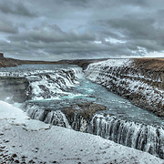 Gullfoss is a waterfall located in the canyon of Hv&iacute;t&aacute; River in southwest Iceland. It&rsquo;s one of the most popular tourist attractions in the country. The wide Hv&iacute;t&aacute; rushes southward and about a kilometre above the falls it flows down into a wide curved staircase and then abruptly plunges into the deep crevice you can see in this image. <br /> <br /> It's an amazing sight and the power of the water is incredible. Iceland is home to many beautiful waterfalls, glaciers, geysirs and meltwaters.