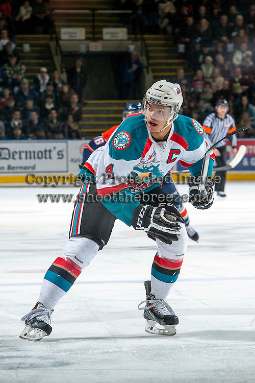 KELOWNA, CANADA -FEBRUARY 1: Madison Bowey #4 of the Kelowna Rockets skates against the Kamloops Blazers on February 1, 2014 at Prospera Place in Kelowna, British Columbia, Canada.   (Photo by Marissa Baecker/Getty Images)  *** Local Caption *** Madison Bowey;