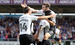 Gwion Edwards of Peterborough United celebrates scoring the opening goal with team-mates Junior Morias and Jack Marriott - Mandatory by-line: Joe Dent/JMP - 26/08/2017 - FOOTBALL - Sixfields Stadium - Northampton, England - Northampton Town v Peterborough United - Sky Bet League One