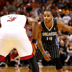 March 3, 2011; Miami, FL, USA; Orlando Magic point guard Jameer Nelson (14) is guarded by Miami Heat shooting guard Dwyane Wade (3) during the second quarter at the American Airlines Arena.    Mandatory Credit: Derick E. Hingle
