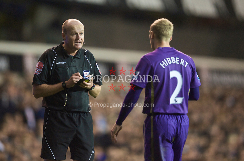 LONDON, ENGLAND - Tuesday, October 27, 2009: Referee Lee Mason books Everton's Tony Hibbert during the League Cup 4th Round match against Tottenham Hotspur at White Hart Lane. (Photo by David Rawcliffe/Propaganda)