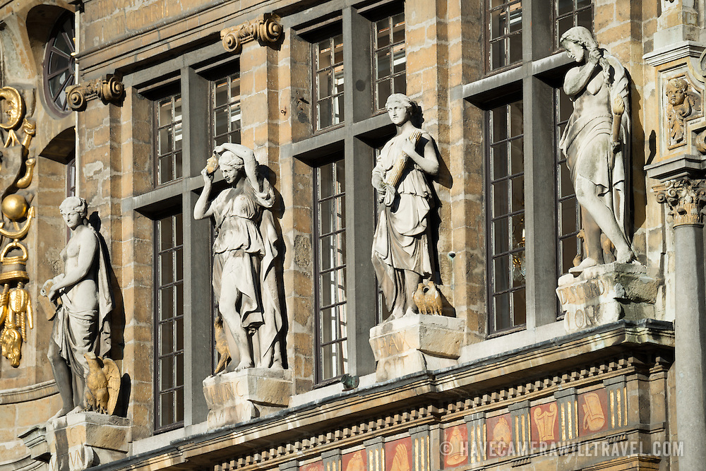 Statues on a building on Grand Place (La Grand-Place), a UNESCO World Heritage Site in central Brussels, Belgium. Lined with ornate, historic buildings, the cobblestone square is the primary tourist attraction in Brussels.