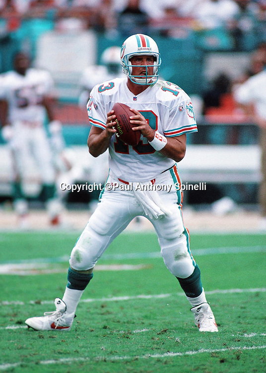 Miami Dolphins quarterback Dan Marino (13) drops back to pass during the NFL football game against the New England Patriots on Nov. 12, 1995 in Miami Gardens, Fla. The Patriots won the game 34-17. (©Paul Anthony Spinelli)