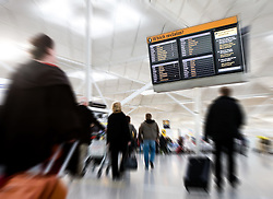 Stansted Airport, airside, passengers in baggage reclaim hall, January 2008. Image Ref CCS00161d, AC