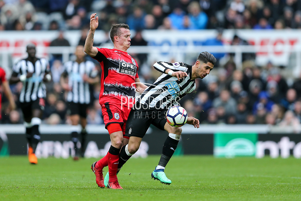 Ayoze Perez (#17) of Newcastle United controls the ball under pressure from Jonathan Hogg (#6) of Huddersfield Town during the Premier League match between Newcastle United and Huddersfield Town at St. James's Park, Newcastle, England on 31 March 2018. Picture by Craig Doyle.