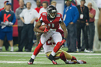 20 January 2013: Wide receiver (11) Julio Jones of the Atlanta Falcons catches a pass and runs against the San Francisco 49ers during the first half of the 49ers 28-24 victory over the Falcons in the NFC Championship Game at the Georgia Dome in Atlanta, GA.