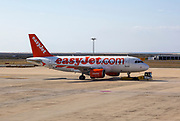 easyJet flight being transported to runway for take-off, Faro airport, Portugal