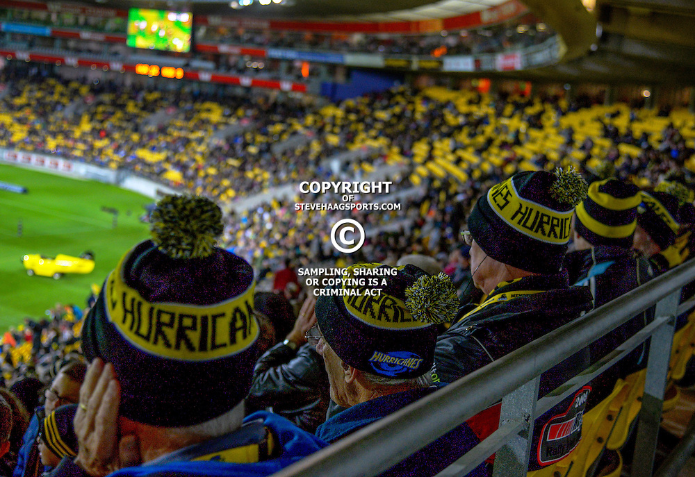 Fans watch from the grandstand during the Super Rugby match between the Hurricanes and Southern Kings at Westpac Stadium, Wellington, New Zealand on Friday, 25 March 2016. Photo: Dave Lintott / lintottphoto.co.nz