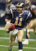 ST. LOUIS - SEPTEMBER 23:  Quarterback Jamie Martin #11 of the St. Louis Rams rolls out while looking for a receiver on a pass play against the New Orleans Saints at the Edward Jones Dome on September 23, 2005 in St. Louis, Missouri. The Rams defeated the Saints 28-17. ©Paul Anthony Spinelli *** Local Caption *** Jamie Martin