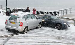 © Licensed to London News Pictures. 15/01/2013..Saltburn, Cleveland, England..As heavy snow falls on Saltburn the notorious Saltburn Bank becomes almost impassable. Here an unlucky driver hits another car as he slid down the bank on fresh snow...Photo credit : Ian Forsyth/LNP
