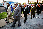 "Members of Nation of Islam march in support of the protesters in Ferguson. Police and protesters clash in the streets of Ferguson. Heavily armed police provoked many of the protesters as they swooped in, guns pointing, to  arrest deemed ""troublemakers"" among the protesters in downtown Ferguson following the killing of unarmed Michael Brown (18)."