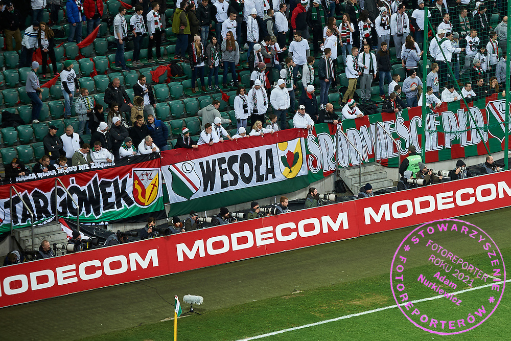Photographers shoots images behind advertises (L) Jacek Prondzynski (Legia) and (2L) Wlodziemierz Sierakowski (freelancer) and (3L) Adam Jagielak (Getty Gallo Images Agency) and (4L) Bartlomiej Zborowski (Polish Press Agency) and (5L) Maciej Gilert (Media Pictures Agency) and (7L) Przemek Wierzchowski (Gazeta Wyborcza Daily) and (9L) Tomasz Jedrzejowski (Bravo Sport Weekly) and (11L) Tomasz Radzik (Superexpress Daily) and (3R) Piotr Kucza (Fakt Daily) and (4R) Kamil Piklikiewicz (East News Agency) during T-Mobile ExtraLeague soccer match between Legia Warsaw and Podbeskidzie Bielsko Biala in Warsaw, Poland.<br /> <br /> Poland, Warsaw, March 01, 2015<br /> <br /> Picture also available in RAW (NEF) or TIFF format on special request.<br /> <br /> For editorial use only. Any commercial or promotional use requires permission.<br /> <br /> Mandatory credit:<br /> Photo by &copy; Adam Nurkiewicz / Mediasport