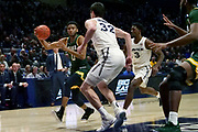 Donald Carey (0) of Siena drives to the lane against Zach Freemantle (32) and Quentin Goodin (3) of Xavier during an NCAA college basketball game, Friday, Nov. 8, 2019, at the Cintas Center in Cincinnati, OH. Xavier defeated Siena 81-63. (Jason Whitman/Image of Sport)