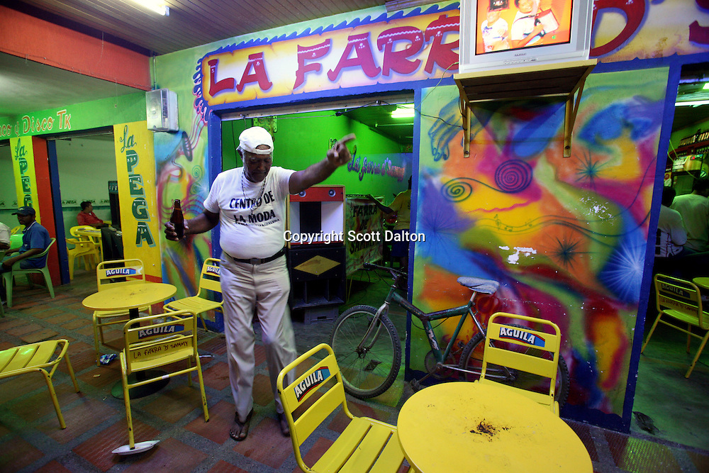 A man dances alone in a bar in Aracataca on Sunday, January 28, 2007.  Aracataca is the hometown of Garcia Marquez, the famed Colombian author most noted for his novel One Hundred Years of Solitude and also the winner of the Nobel Prize for literature. (Photo/Scott Dalton)