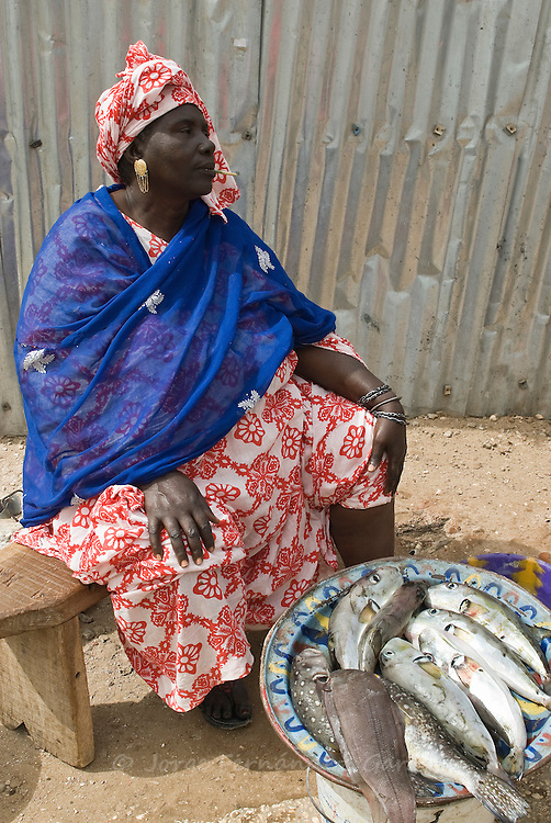 Senegalese woman selling fish on the streets of Sant Louis. Senegal, Africa.