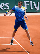 Daniel Brands of Germany competes in men's singles while Day Second during The French Open 2013 at Roland Garros Tennis Club in Paris, France...France, Paris, May 27, 2013..Picture also available in RAW (NEF) or TIFF format on special request...For editorial use only. Any commercial or promotional use requires permission...Mandatory credit:.Photo by © Adam Nurkiewicz / Mediasport
