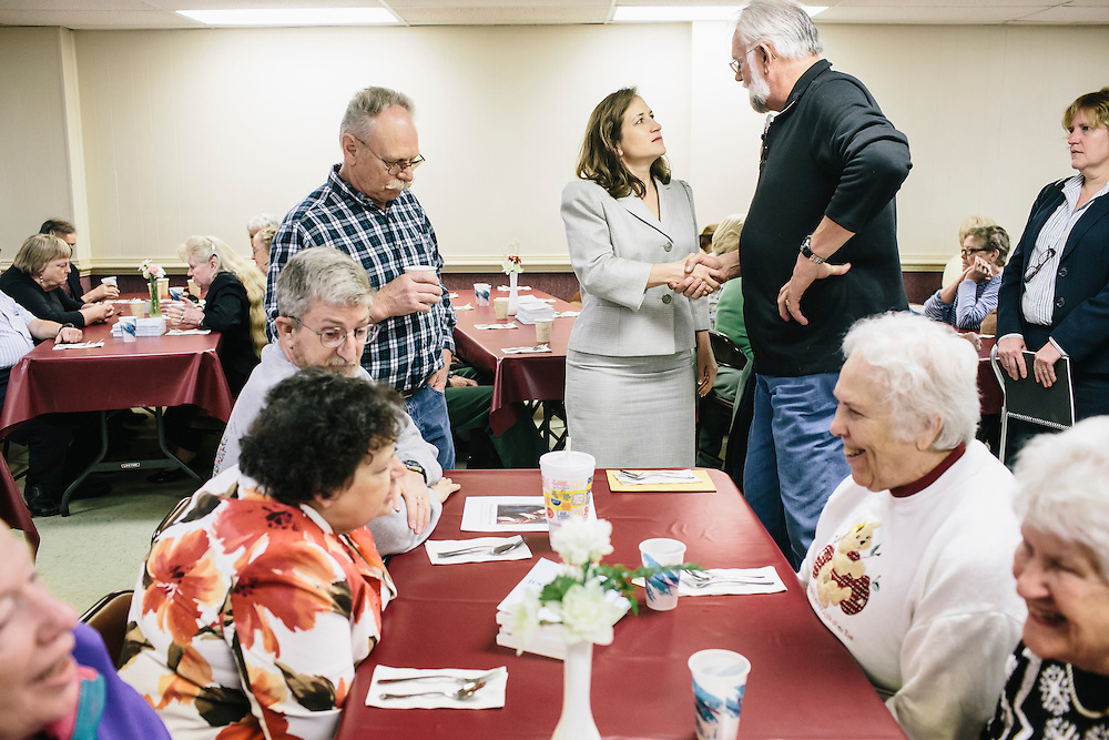 West Virginia Secretary of State Natalie Tennant talks with guests, including Larry Pownell, right, at Romney First United Methodist Church in Romney, W.V. during a Lenten Luncheon on Wednesday, April 16, 2014. Tennant is running for a US Senate seat in West Virginia against Republican Rep. Shelley Moore Capito.