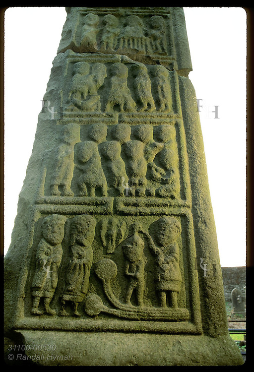 Lower panel of high cross in cemetery of St. Columba's Church depicts baptism; Kells. Ireland
