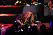Grammy winner Melissa Etheridge rocks the Hardrock casino in Biloxi Mississippi Friday 30, 2010 as part of her FEARLESS LOVE TOUR.Melissa jammed with her new band and guitarist John Shanks, Etheridge plays Shanks guitar blind from behind him during the show.She does the same for bassist Sean Hurley. Photo © Suzi Altman