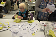 Tellers carrying out the counting of ballot papers at the count at Bidston Tennis Centre, Wirral for the Wirral West constituency in the 2015 UK General Election. The constituency was held by Esther McVey for the Conservative Party, who won the seat from Labour at the 2010 General Election. The constituency was one of the key marginal seats contested between the two main UK political parties and was won by the Labour Party.