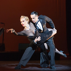 © Licensed to London News Pictures. 26/01/2015. London, England. Pictured: Marcos Esteban Roberts and Louise Junqueira Malucelli dancing. Argentina's dance company Tango Fire returns to the Peacock Theatre, London, with their show Flames of Desire from 27 January to 14 February 2015. Photo credit: Bettina Strenske/LNP