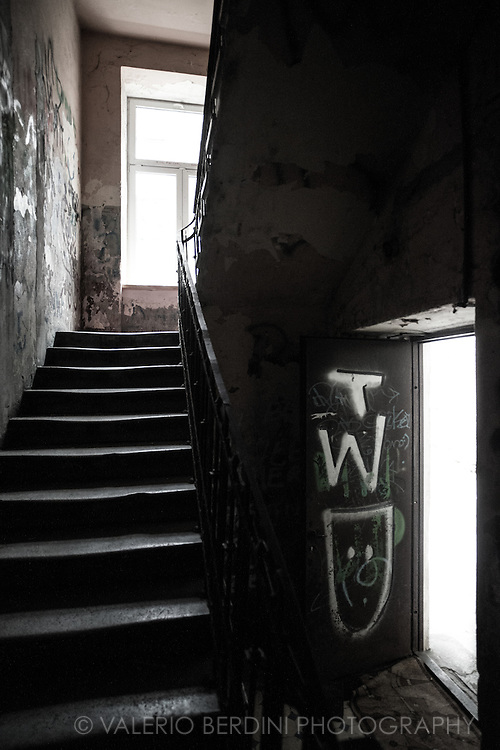 The staircase inside one of the Walicow street units, rundown, dirty and full of graffiti