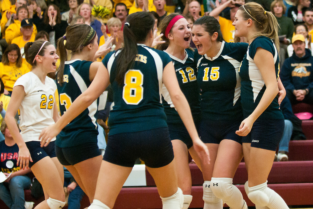 Lathan Goumas | The Bay City Times..November 10, 2011 - Members of the Valley Lutheran High School volleyball team react to scouring a point during the Class C regional championship volleyball match against Unionville-Sebewaing Area High School at Reese High School on Thursday. Valley Lutheran defeated Unionville-Sebewaing in three games.