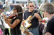 Warwick, New York Singer E'lissa Jones and her group perform for a crowd in a park during the Applefest