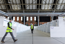© Licensed to London News Pictures. 09/04/2020. Manchester, UK. Rows of patient bays , each of which will have a bed with power and an oxygen supply , are divided up in to wards , at the facility . The National Health Service is building a 648 bed field hospital for the treatment of Covid-19 patients , at the historical railway station terminus which now forms the main hall of the Manchester Central Convention Centre . The facility is due to open on Easter Monday , 13th April 2020 , and will treat patients from across the North West of England , providing them with general medical care and oxygen therapy after discharge from Intensive Care Units . Photo credit: Joel Goodman/LNP