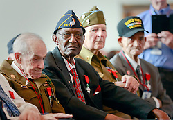 06 June 2014. The National WWII Museum, New Orleans, Lousiana. <br /> WWII veteran Platoon Sgt Lamore Carter, (2nd left) 291st Trucking company is honored with the French Legion of Honor medal. <br /> Photo; Charlie Varley/varleypix.com