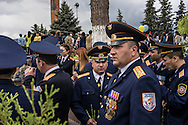 Military officers wait for the start of a ceremony commemorating both the victory over Nazi Germany in the Second World War as well as the fall of the strategic town of Shushi to Armenian forces on Monday, May 9, 2016 in Stepanakert, Nagorno-Karabakh.