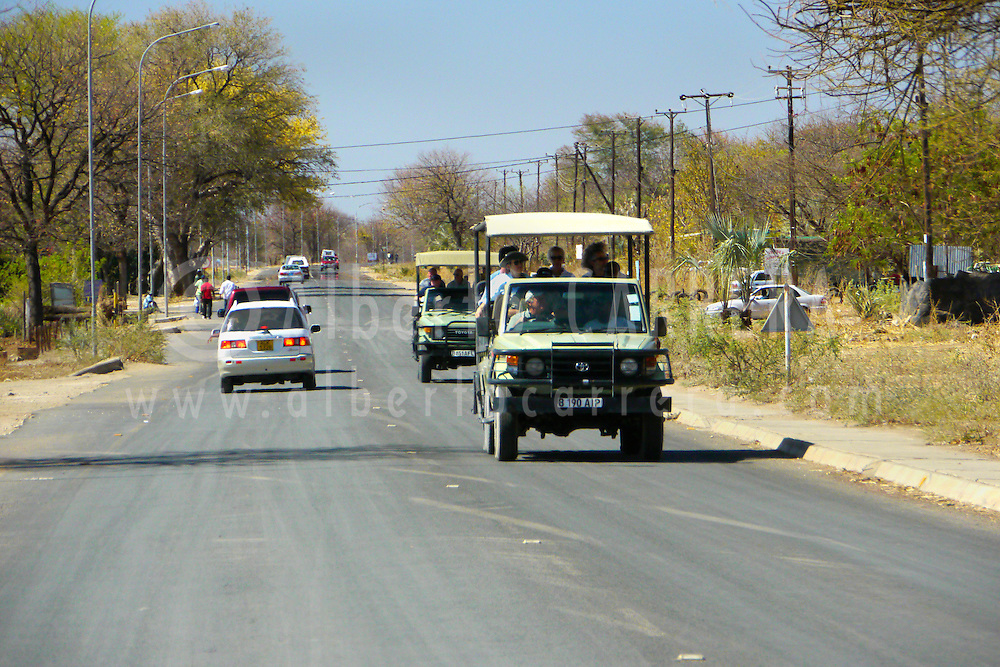 Alberto Carrera, Kasane road and Tourist safari cars,Kasane, Chobe National Park, Botswana, Africa
