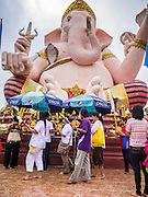 "29 SEPTEMBER 2012 - NAKORN NAYOK, THAILAND:  Thai Buddhists process around a statue of Ganesh while they carry offerings to Ganesh during observances of Ganesh Ustav at Wat Utthayan Ganesh, a temple dedicated to Ganesh in Nakorn Nayok, about three hours from Bangkok. Many Thai Buddhists incorporate Hindu elements, including worship of Ganesh into their spiritual life. Ganesha Chaturthi also known as Vinayaka Chaturthi, is the Hindu festival celebrated on the day of the re-birth of Lord Ganesha, the son of Shiva and Parvati. The festival, also known as Ganeshotsav (""festival of Ganesha"") is observed in the Hindu calendar month of Bhaadrapada, starting on the the fourth day of the waxing moon. The festival lasts for 10 days, ending on the fourteenth day of the waxing moon. Outside India, it is celebrated widely in Nepal and by Hindus in the United States, Canada, Mauritius, Singapore, Thailand, Cambodia, Burma , Fiji and Trinidad & Tobago.     PHOTO BY JACK KURTZ"