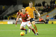 Nottingham Forest midfielder Ben Osborn tracked by Wolverhampton Wanderers midfielder Kevin McDonald during the Sky Bet Championship match between Wolverhampton Wanderers and Nottingham Forest at Molineux, Wolverhampton, England on 11 December 2015. Photo by Alan Franklin.