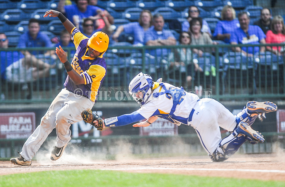 Oxford High's Thomas Dillard (23) tags out Hattiesburg's Chris Cooley (9) in the MHSAA Class 5A championship series at Trustmark Park in Pearl, Miss. on Thursday, May 19, 2016. Oxford won 10-0 to win its second straight state title.