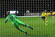 Alex Bass (35) of Portsmouth dives the right way to get his hand to the ball during the penalty shoot out but it shill goes in the net during the Leasing.com EFL Trophy match between Oxford United and Portsmouth at the Kassam Stadium, Oxford, England on 8 October 2019.
